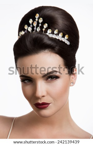 Beautiful young lady with a tiara - stock photo