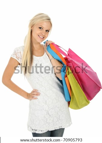 Beautiful young lady with brightly colored shopping bags - stock photo