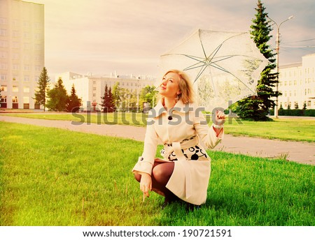 beautiful young lady with umbrella in city without people