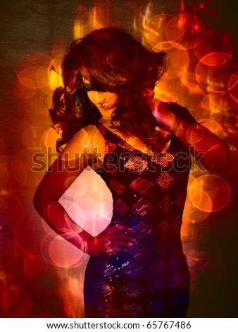 beautiful young Latin American woman in fashion sequin dress dancing with curly hair blowing on bright lights - stock photo