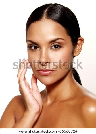 Beautiful young latin woman on white background. - stock photo