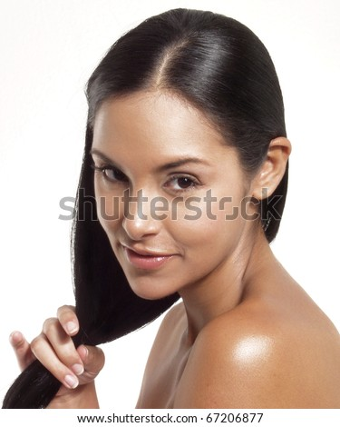 Beautiful young latin woman on white background. Closeup portrait of young beautiful woman after bath - spa - stock photo