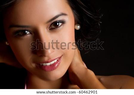 Beautiful young latin woman smiling - stock photo