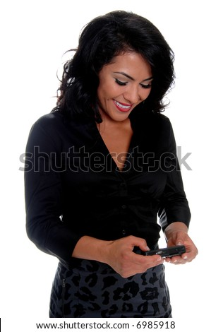 Beautiful young latina business woman sending a text message on a cell phone