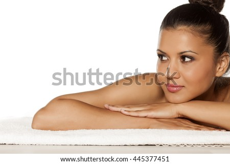 beautiful young latina lying on the towel - stock photo
