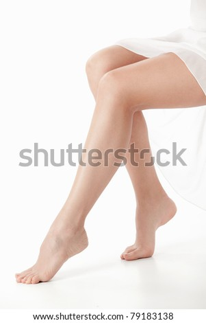 Beautiful young legs on a white background - stock photo
