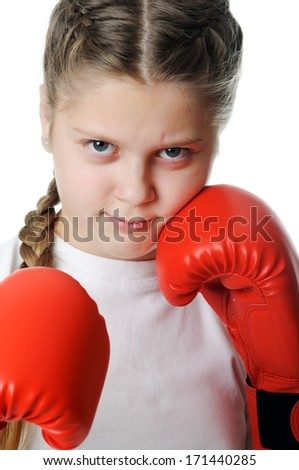 Beautiful young little girl wearing a pair of boxing gloves