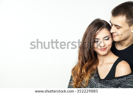 beautiful young love couple isolated on white background