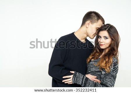 beautiful young love couple isolated on white background - stock photo