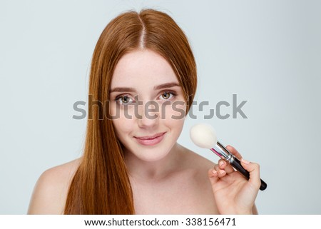 Beautiful young lovely attractive redhead woman with freckles portrait isolated on white - stock photo