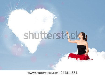 Beautiful young lovely woman sitting on cloud with heart - stock photo