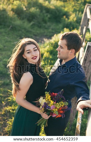 Beautiful young loving couple enjoying good weather in summer