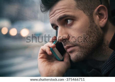 Beautiful young man talking on the phone