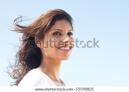 beautiful young middle eastern woman portrait on beach - stock photo