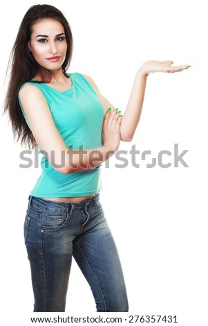 Beautiful young mixed latino / caucasian woman presenting your very exciting product. Isolated on white. - stock photo
