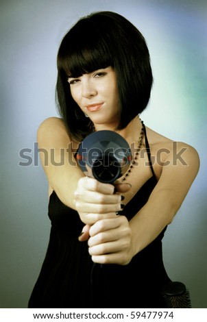 beautiful young model holding a hair dryer
