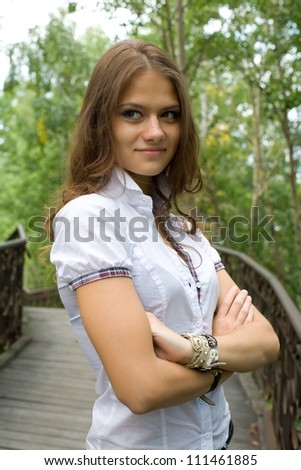 Beautiful young model on an old suspension bridge