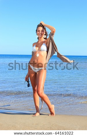 Beautiful young model on the beach