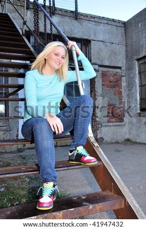 beautiful young model posing in an urban setting - stock photo