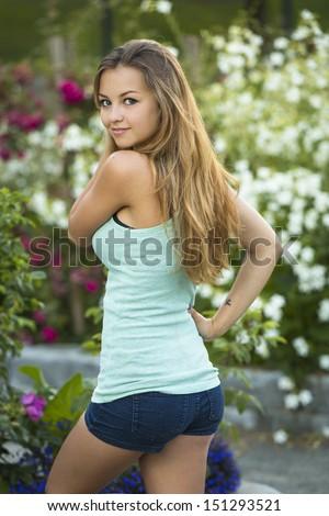 Beautiful young model posing outdoors - stock photo
