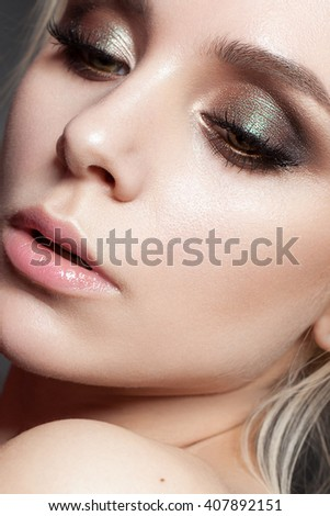 beautiful young model with evening make up, perfect skin. Trendy smoky eyes - stock photo
