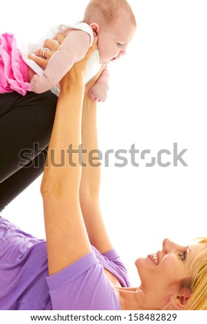 Beautiful Young Mom Doing Baby Yoga isolated on white background. - stock photo