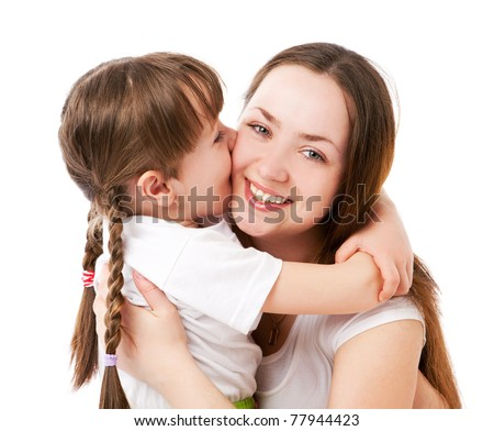 beautiful young mother and her five year old daughter embracing and kissing - stock photo
