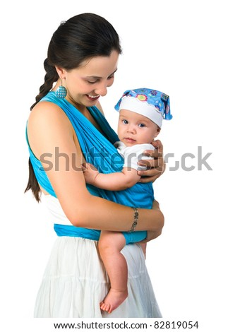 Beautiful young mother carrying her baby in a sling