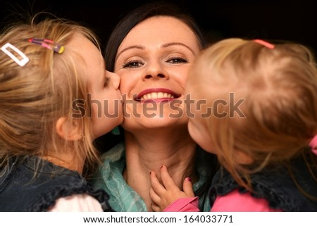 Beautiful young mother daughter - stock photo