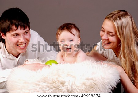 Beautiful young mother, father and little boy