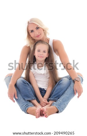 beautiful young mother sitting with little daughter isolated on white background