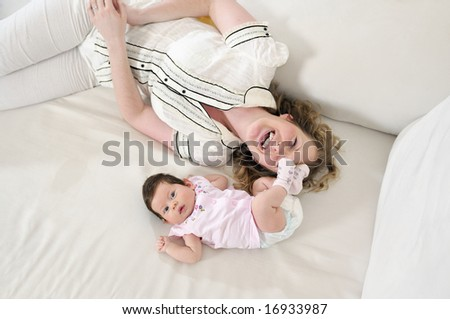 beautiful young mother small with little bab - stock photo