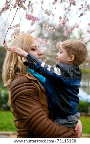 Beautiful young mother with her son at spring