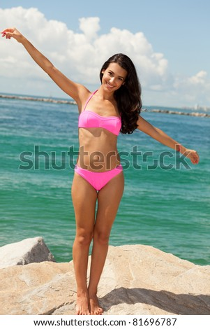 Beautiful young multicultural woman enjoying South Beach in Miami. - stock photo