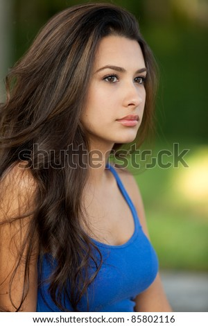 Beautiful young multicultural woman in an outdoor setting.
