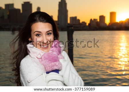 Beautiful young multicultural woman outdoors in a downtown urban setting by the bay. - stock photo