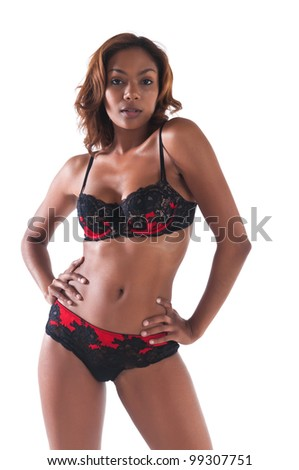 Beautiful young multiracial woman in red and black lingerie - stock photo