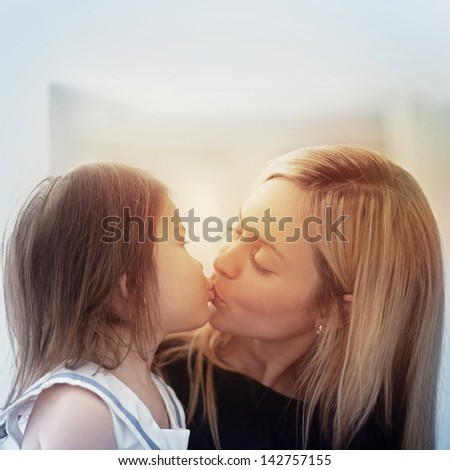 Beautiful young mum and her daughter with blonde hair - stock photo