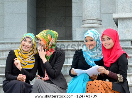 beautiful young muslim businesswoman sharing info - stock photo