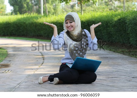 beautiful young Muslim girl happy emotion with laptop - stock photo