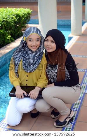 beautiful young muslim student - stock photo