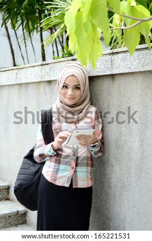 beautiful young muslim student confident portrait.  - stock photo
