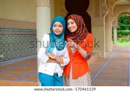 beautiful young muslim student smile happy friendship - stock photo