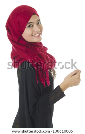 Beautiful young Muslim woman over on white background. - stock photo