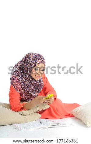 beautiful young muslim woman texting using cellphone, isolate on white background - stock photo