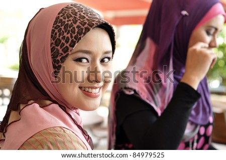 beautiful young muslim woman was glanced into the camera - stock photo