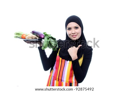 Beautiful Young Muslim Woman with fresh Vegetables.Dieting Concept.Vegetarian food on white - stock photo