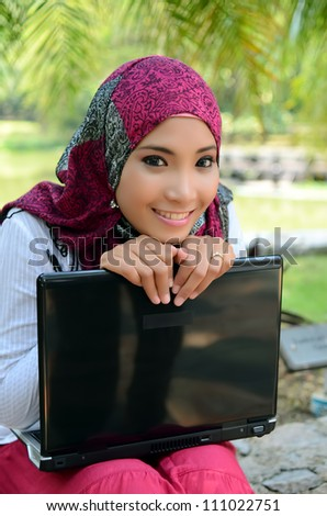 Beautiful young muslim woman with smile - stock photo