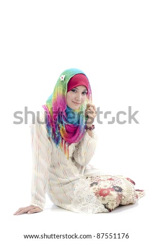 Beautiful young Muslim women with colorful scarf. - stock photo
