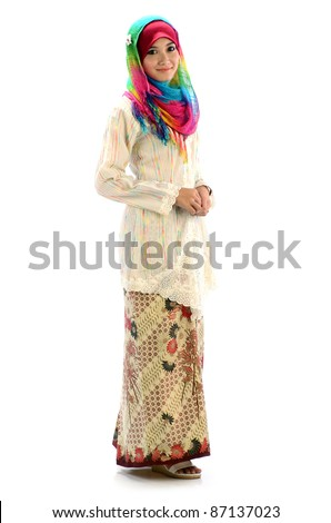 Beautiful young Muslim women with colorful scarf and traditional dress. - stock photo
